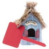 Pequeño hogar con la muestra roja Foto de archivo libre de regalías