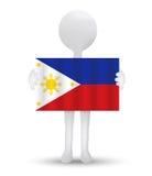 pequeño hombre 3d que sostiene una bandera de la República de Filipinas Imagen de archivo libre de regalías