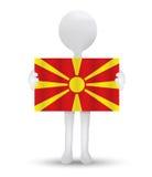 pequeño hombre 3d que sostiene una bandera del República de Macedonia Fotografía de archivo libre de regalías
