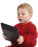 Pequeño muchacho con la calculadora Imagen de archivo libre de regalías