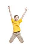 Pequeño niño alegre divertido que salta y que ríe Imagen de archivo