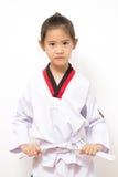 Pequeño niño asiático en la acción que lucha Imagen de archivo libre de regalías