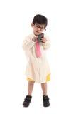 Pequeño niño asiático que finge ser hombre de negocios Imagen de archivo libre de regalías