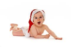 Pequeño niño con el bebé del sombrero de Papá Noel Imágenes de archivo libres de regalías