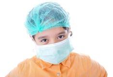 Pequeño niño con una máscara fotografía de archivo libre de regalías