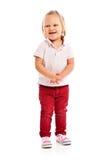 Pequeño niño feliz que presenta en estudio fotografía de archivo libre de regalías