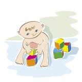 Pequeño niño que juega con los cubos Imagen de archivo libre de regalías