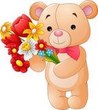 Pequeño oso lindo que sostiene un ramo Fotografía de archivo libre de regalías
