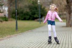 Pequeño patinador Imagen de archivo libre de regalías