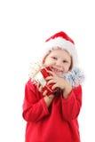 Pequeño Santa con el presente Imágenes de archivo libres de regalías