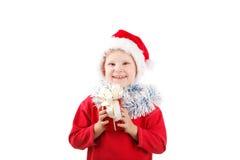Pequeño Santa con el presente Fotos de archivo libres de regalías
