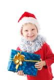 Pequeño Santa con el presente Fotografía de archivo libre de regalías