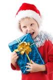 Pequeño Santa con el presente Imagen de archivo