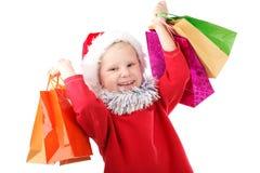 Pequeño Santa con los presentes Fotos de archivo