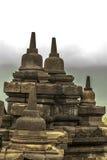 Pequeño Stupas en una pared de la isla de Borobudur Java, Indonesia Foto de archivo libre de regalías