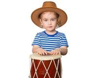 Pequeño tambor divertido del juego de la muchacha Fotos de archivo