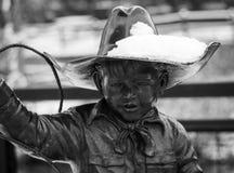 Pequeño vaquero Roping el invierno imagen de archivo libre de regalías