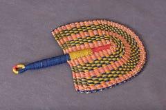 Pequeño ventilador plegable africano Fotografía de archivo libre de regalías