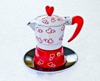 Pequeño y brillante, pote del café Foto de archivo libre de regalías