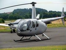 Pequeños avión y helicóptero imagenes de archivo