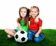 Pequeños cabritos con el balón de fútbol Fotos de archivo libres de regalías