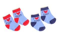 Pequeños calcetines lindos del bebé aislados en blanco Fotografía de archivo libre de regalías