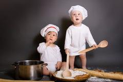 Pequeños cocineros Fotos de archivo