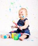 Pequeños colores lindos de la salpicadura de la pintura del bebé foto de archivo