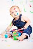 Pequeños colores lindos de la salpicadura de la pintura del bebé imagen de archivo