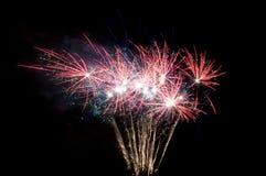 Pequeños fuegos artificiales en fondo negro Imágenes de archivo libres de regalías