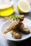 Pequeños pescados fritos Imagen de archivo libre de regalías