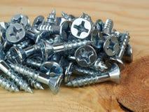 Pequeños tornillos de madera Imágenes de archivo libres de regalías