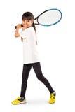 Pequeña muchacha asiática que sostiene la estafa de tenis Fotografía de archivo libre de regalías