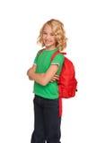 Pequeña muchacha rubia en camiseta verde con el bolso rojo Fotografía de archivo