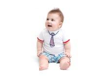 Pequeña sentada del bebé Imagenes de archivo