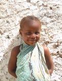 Pequeña sonrisa africana dulce de la muchacha Foto de archivo libre de regalías