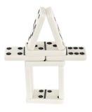 Pequeña torre hecha de los huesos de los dominós Foto de archivo libre de regalías