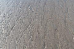 Pequeñas calas de marea con el drenaje de calas del agua Fotos de archivo libres de regalías