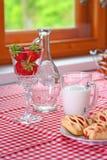 Pequeno almoço com leite e pão da morango Fotos de Stock Royalty Free