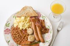 Pequeno almoço inglês com sumo de laranja Fotos de Stock