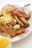 Pequeno almoço inglês com sumo de laranja Fotografia de Stock