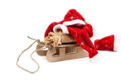 Pequeno trenó com saco e roupa de Santa Claus Fotografia de Stock Royalty Free