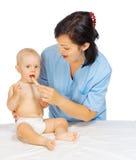 Pequeño bebé con el doctor Imágenes de archivo libres de regalías