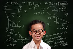 Pequeño estudiante asiático Boy Math Genius Imagen de archivo libre de regalías