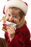Pequeño gastrónomo en el sombrero de Santa, aislado Foto de archivo