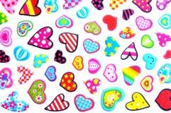 Pequeños corazones coloridos Imágenes de archivo libres de regalías