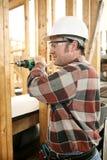 Perçage de charpentier sans risque Images libres de droits
