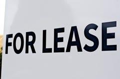 Per il segno del contratto d'affitto, nero sulle lettere maiuscole bianche e Immagine Stock