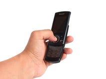 Per mezzo del telefono mobile Fotografia Stock