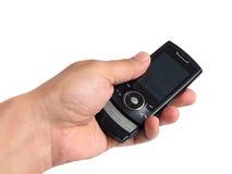 Per mezzo del telefono mobile Immagini Stock
